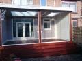 Veranda, Veranda Plaza, Glazen schuifwanden, terrasoverkapping, overkapping, buitenkamer, tuinkamer, Carport houtkachel, lichtstraat, daklicht, balustrade, terrasverwarming, tuin, terras, houten vloer.