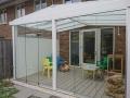 Exclusieve tuinkamer met glazen schuifwanden van Veranda Plaza 14